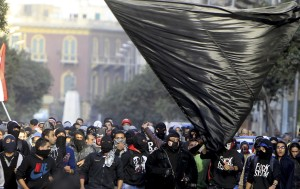 Members of the Black Bloc are seen during the protest in Tahrir Square in Cairo
